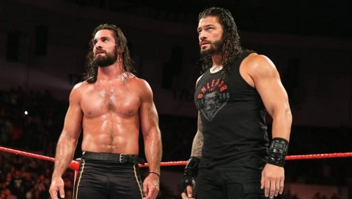 Seth Rollins with Roman Reigns